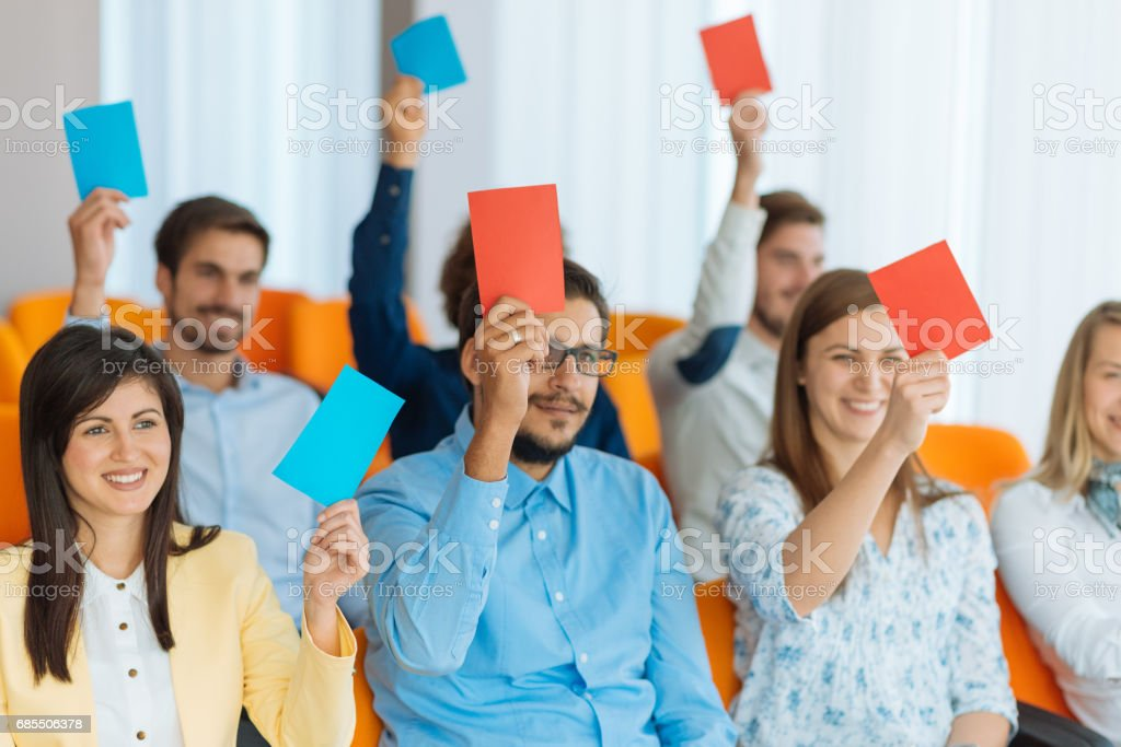 Participants in local assembly vote for new decisions stock photo