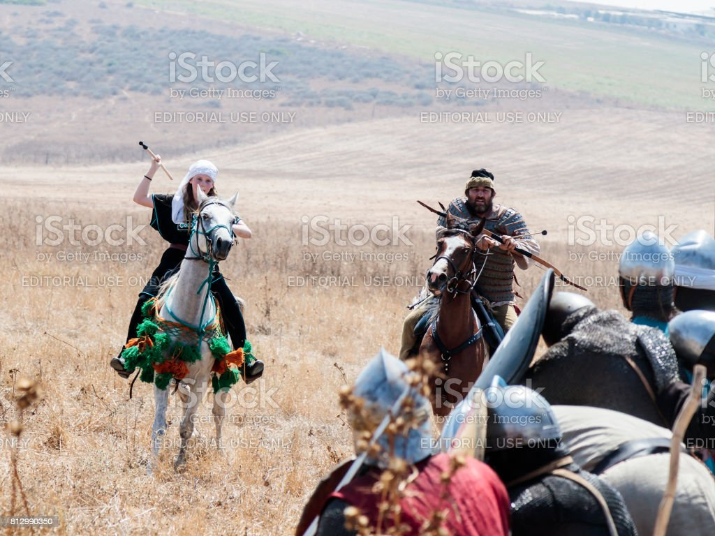 Participants in the reconstruction of Horns of Hattin battle in 1187 moving around the battlefield near Tiberias, Israel stock photo