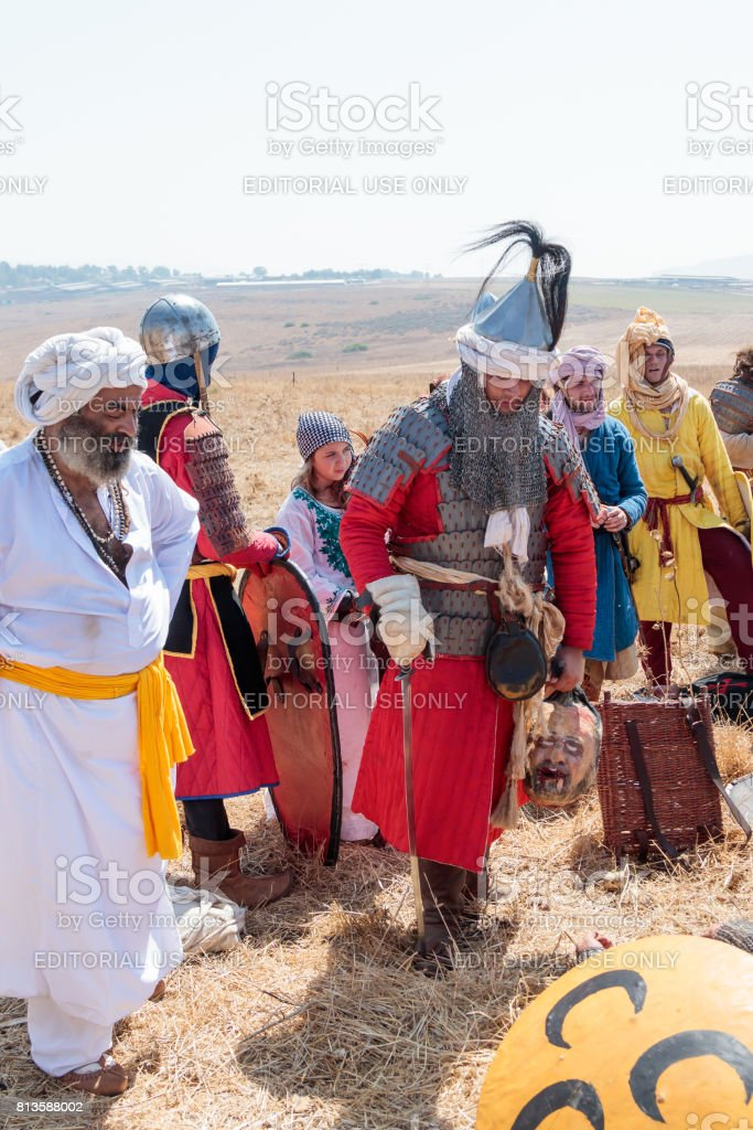 Participants in the reconstruction of Horns of Hattin battle in 1187 dressed in the costumes of soldiers Saladin celebrate victory near Tiberias, Israel stock photo