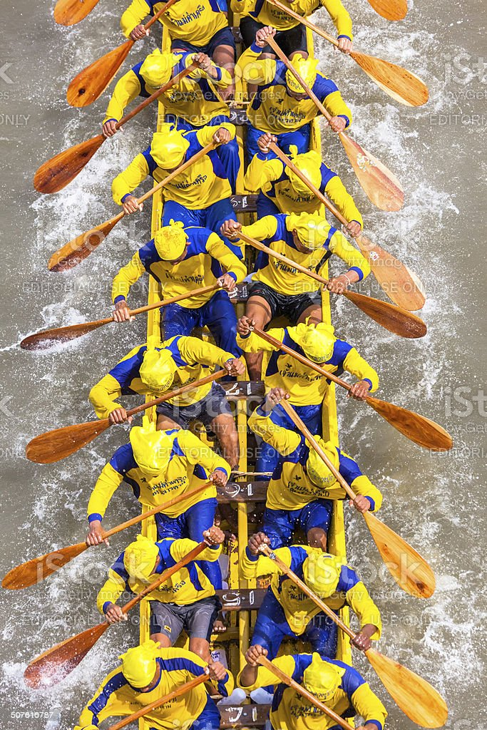 Participants of a dragon boat race in action stock photo