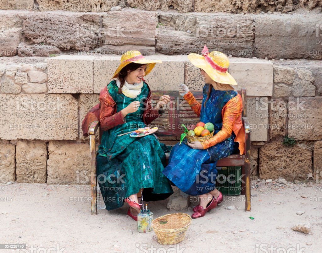 Participants of festival dressed as artist on bench and paint stock photo