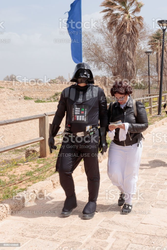 Participants of festival dressed as Darth Vader and Princess Leia stock photo