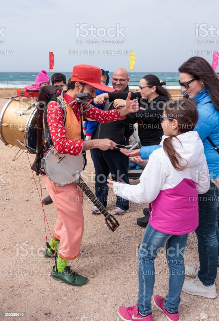 Participants of festival plays musical instruments and shows his art stock photo