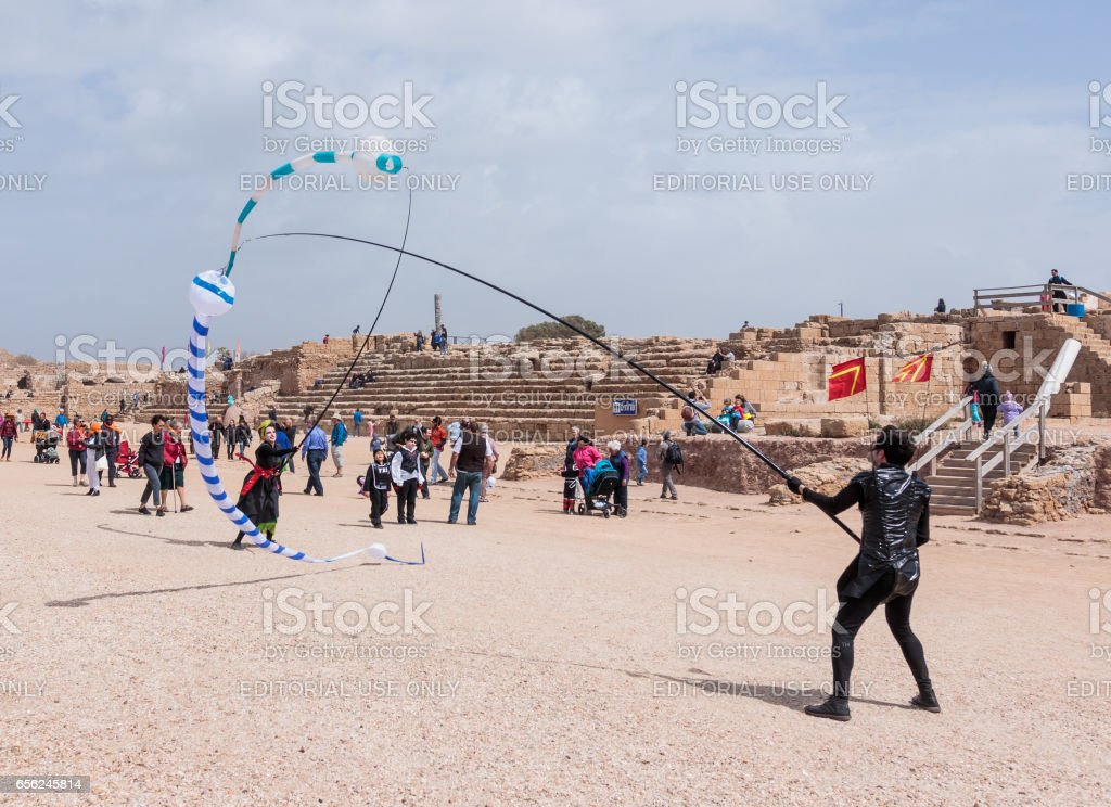 Participants of festival show a show with kites stock photo