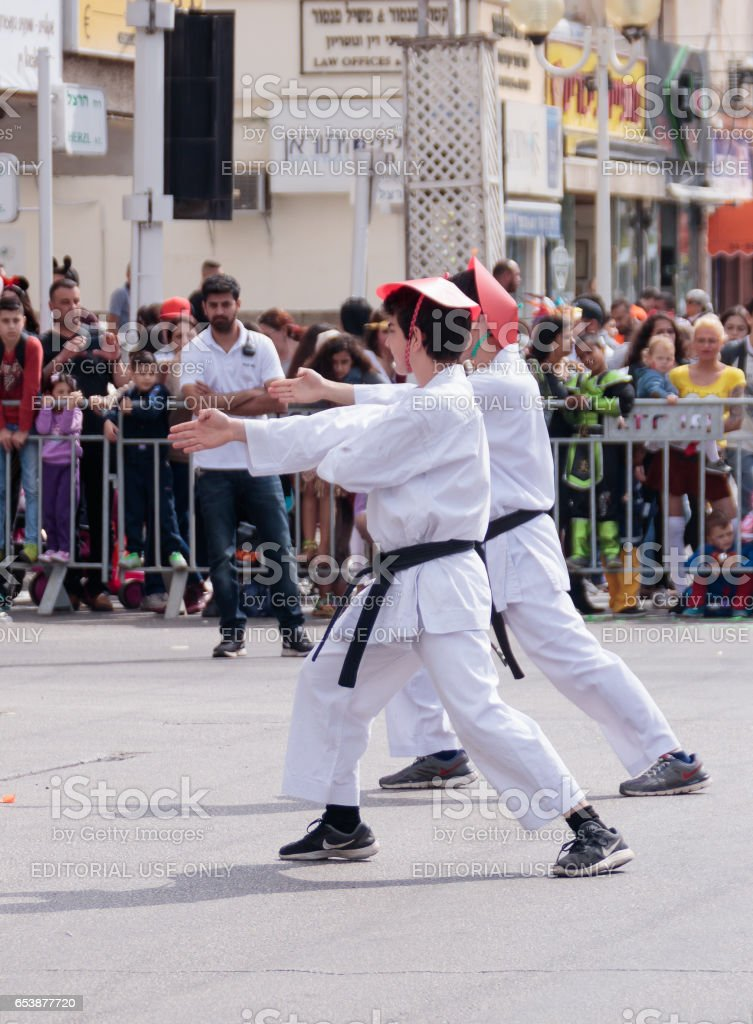 Participants of karate section demonstrate their skills for the viewers stock photo