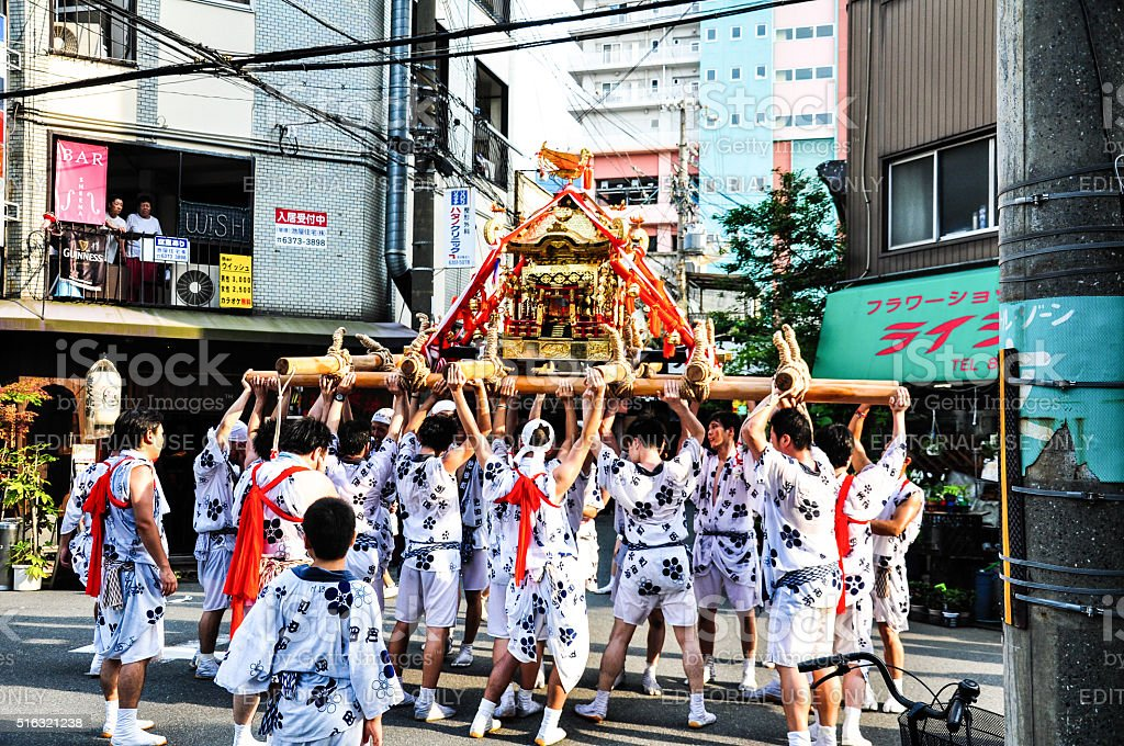 Participants of Tenjin Matsuri worships the golden shrine, July stock photo