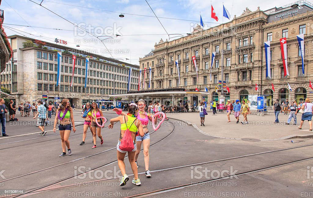 Participants of the Street Parade in Zurich on Paradeplatz square stock photo