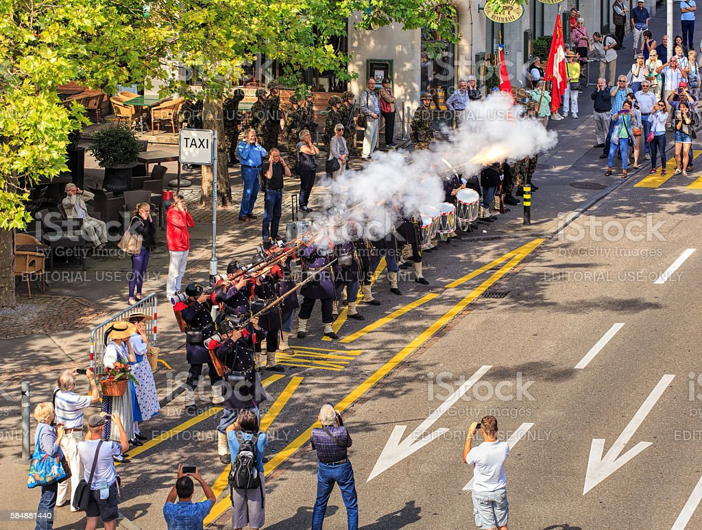 Participants of the Swiss National Day parade in Zurich shooting stock photo