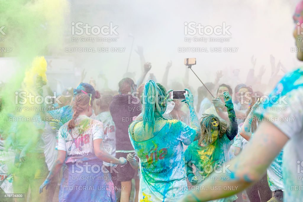 Participator in the Color Run waiving arms in the air stock photo