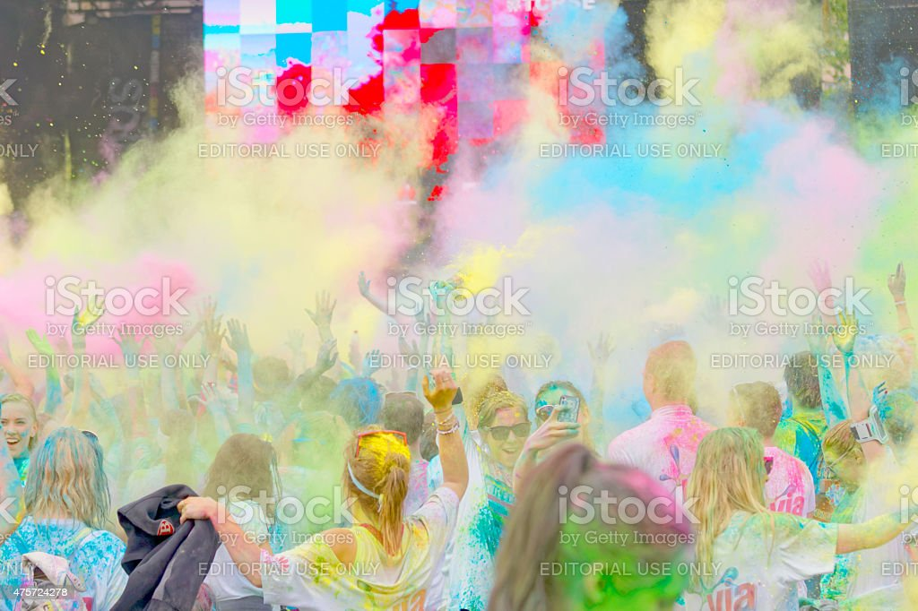 Participators in the Color Run waiving arms in the sky stock photo