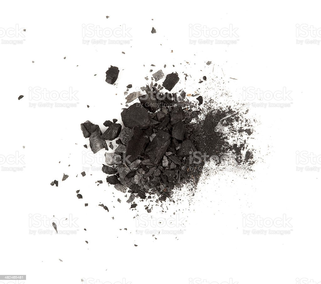 particles of charcoal on a white background. Placer cosmetics stock photo