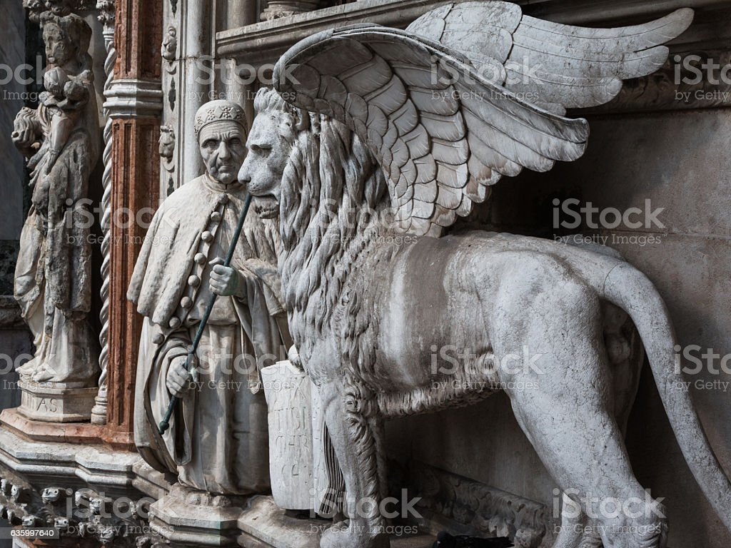 Particular of Doge's Palace Facade in Venice: Marble Winged Lion stock photo