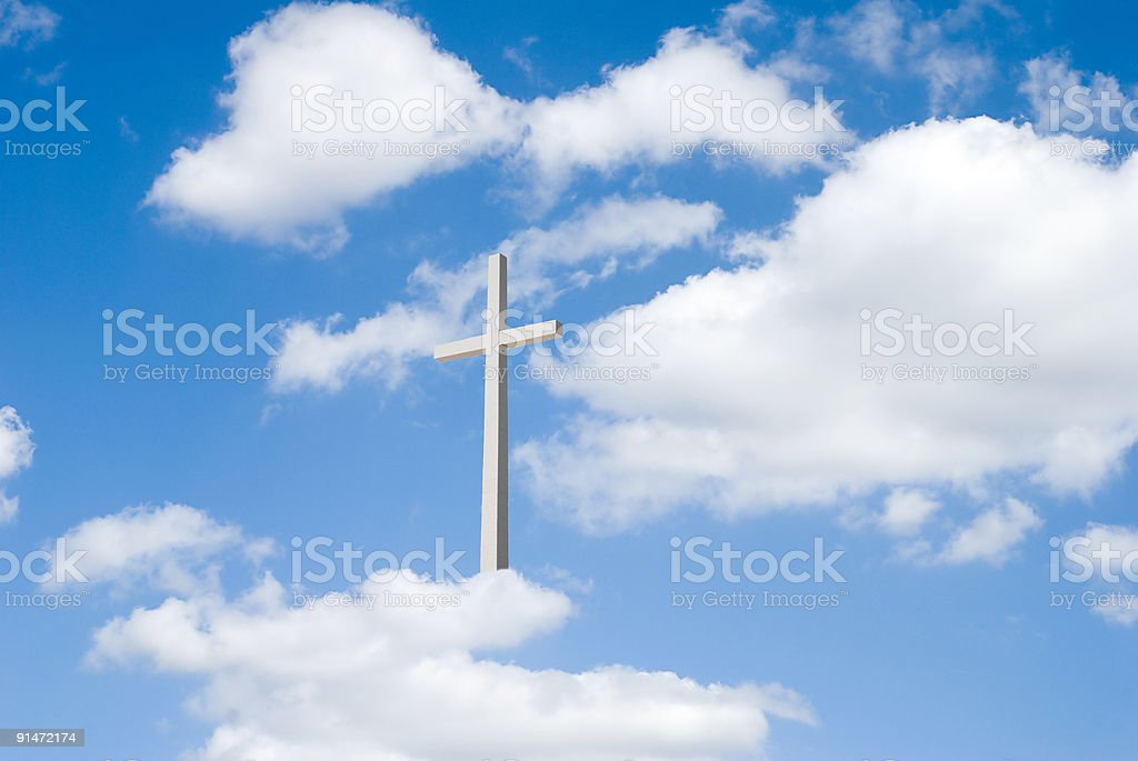 Partly cloudy blue sky  with cross royalty-free stock photo