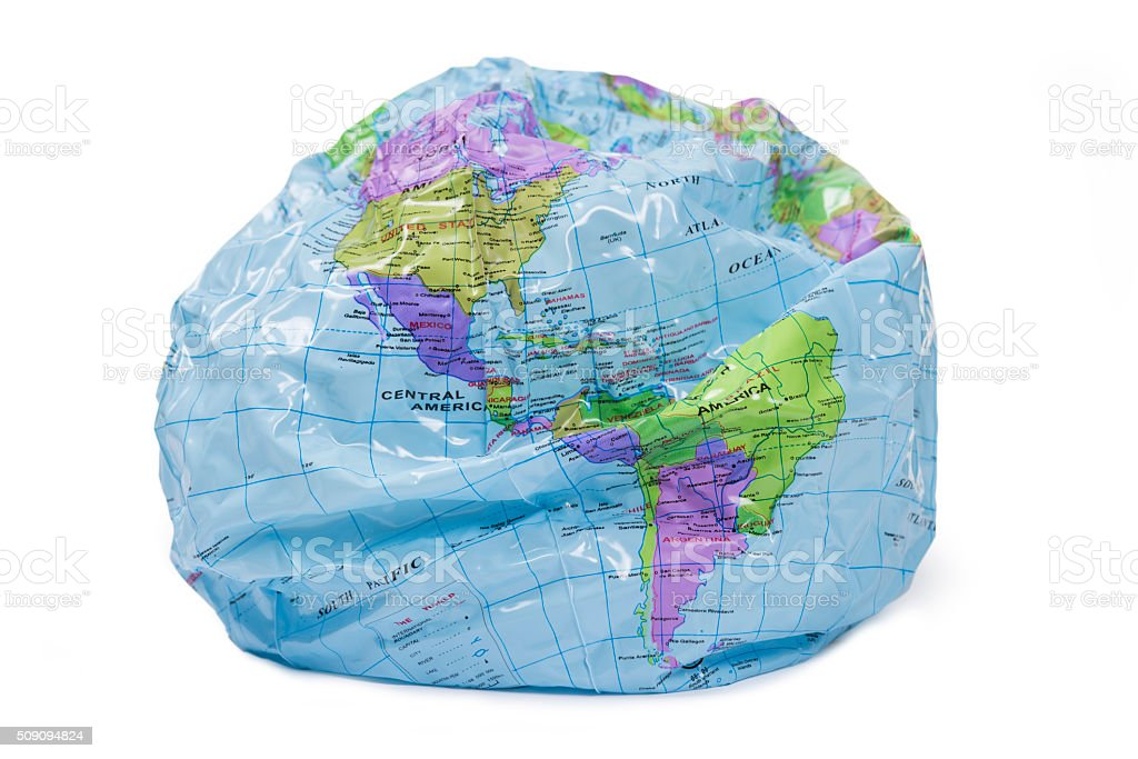Partly deflated world globe with clipping path stock photo