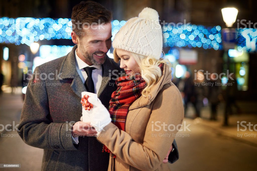 Partner can always surprise his woman stock photo