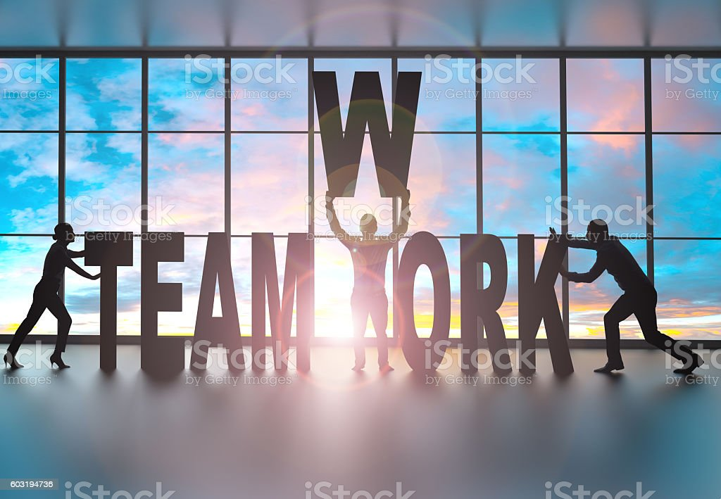 Partners building the word teamwork stock photo