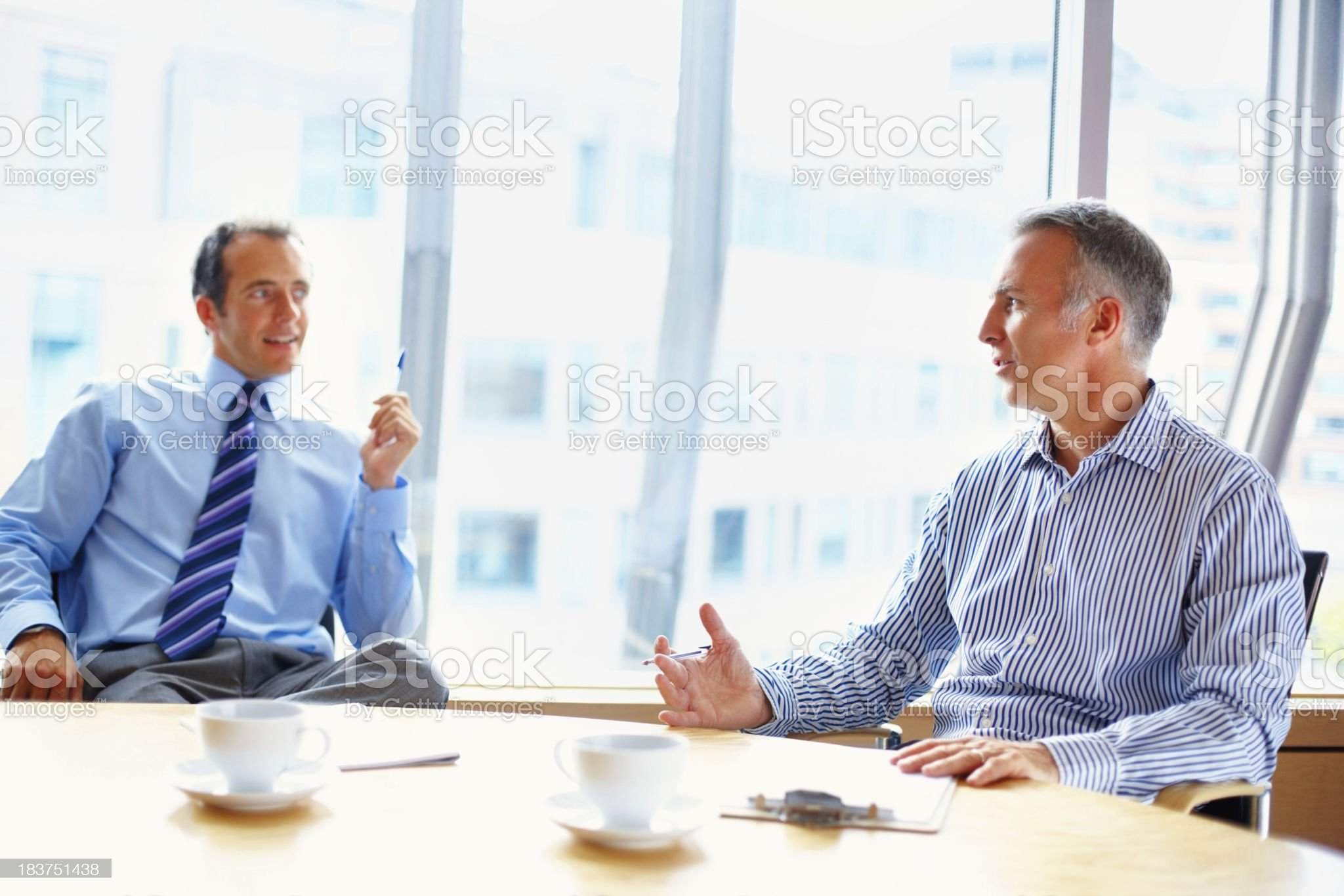 Partners in casual meeting over coffee royalty-free stock photo