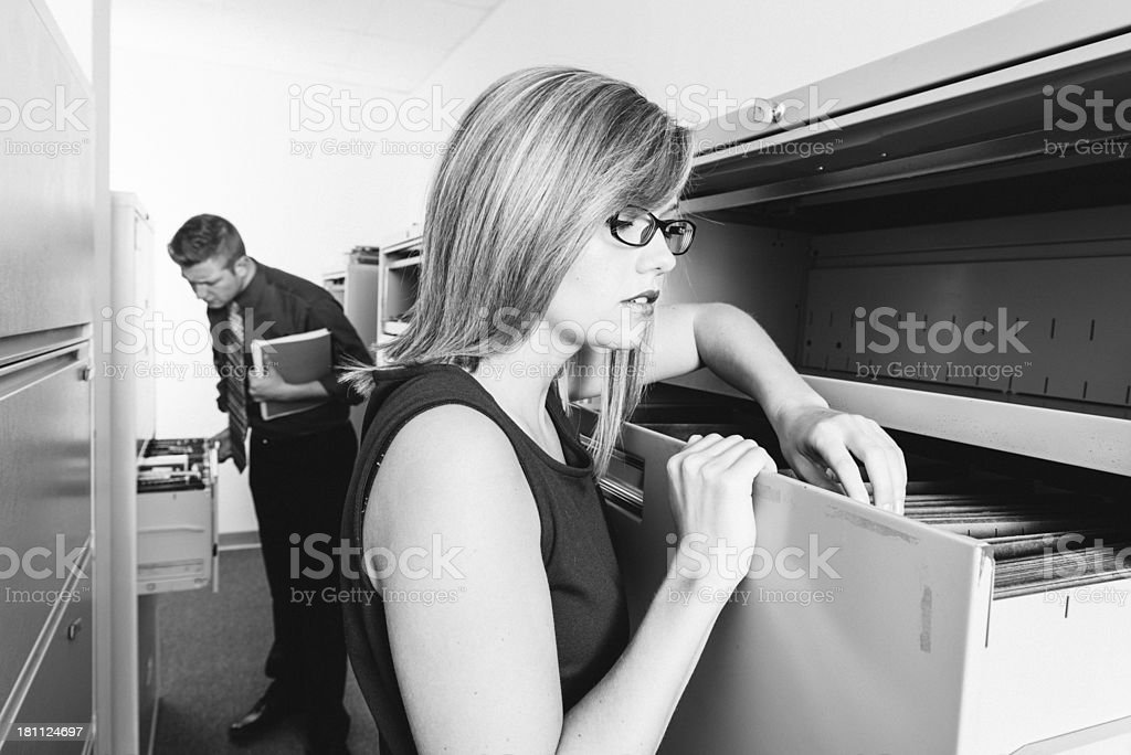 Partners searching in filing cabinets royalty-free stock photo