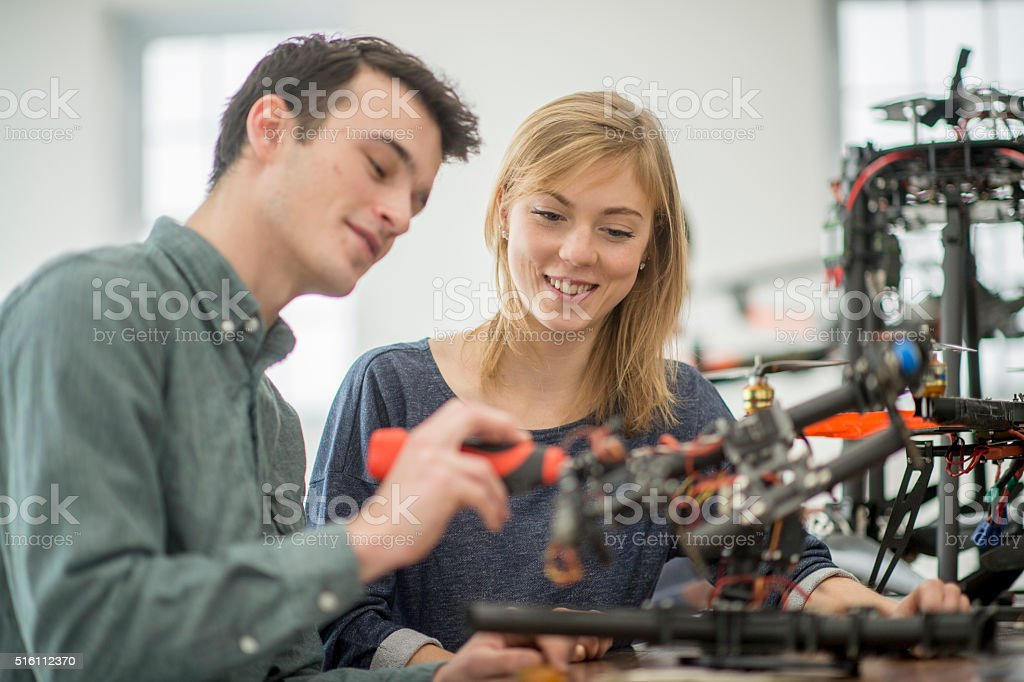 Partners Working on a Drone in the Lab stock photo