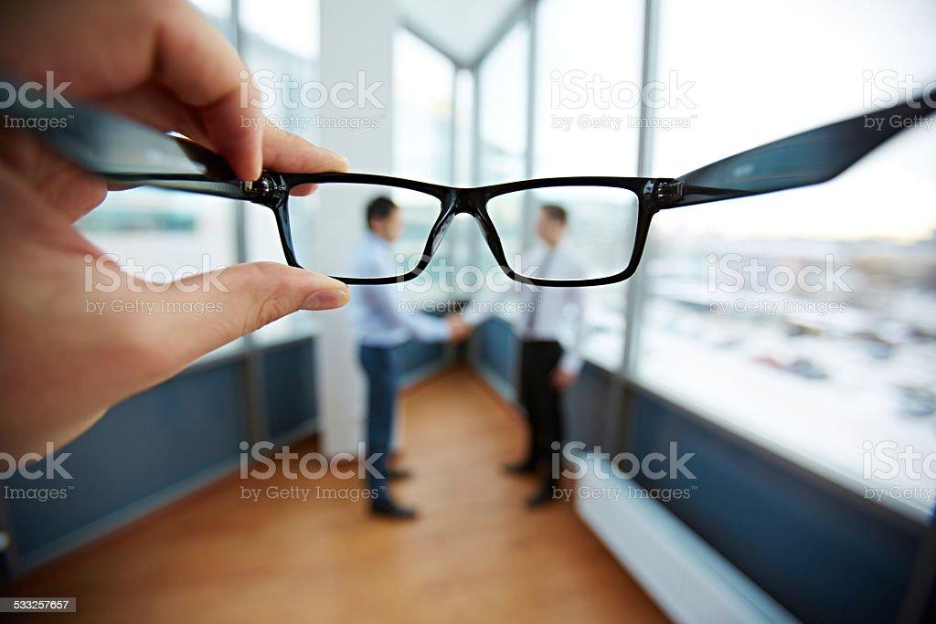 Partnership through glasses stock photo