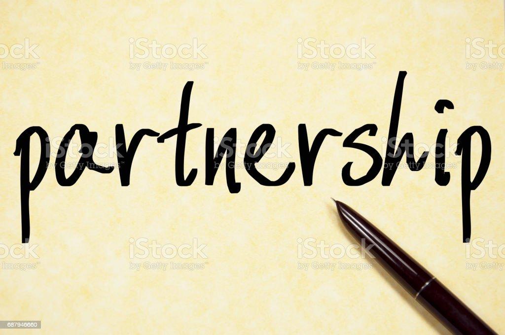 partnership word write on paper stock photo