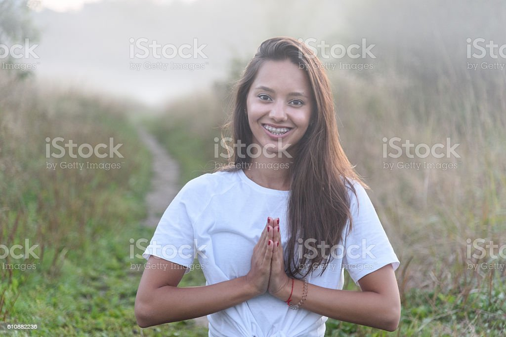 Partrait of girl smiling in the mist stock photo