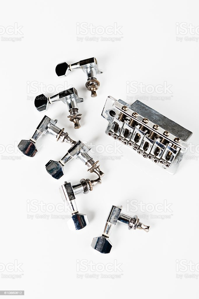 Parts of a disassembled electric guitar, including tuners stock photo