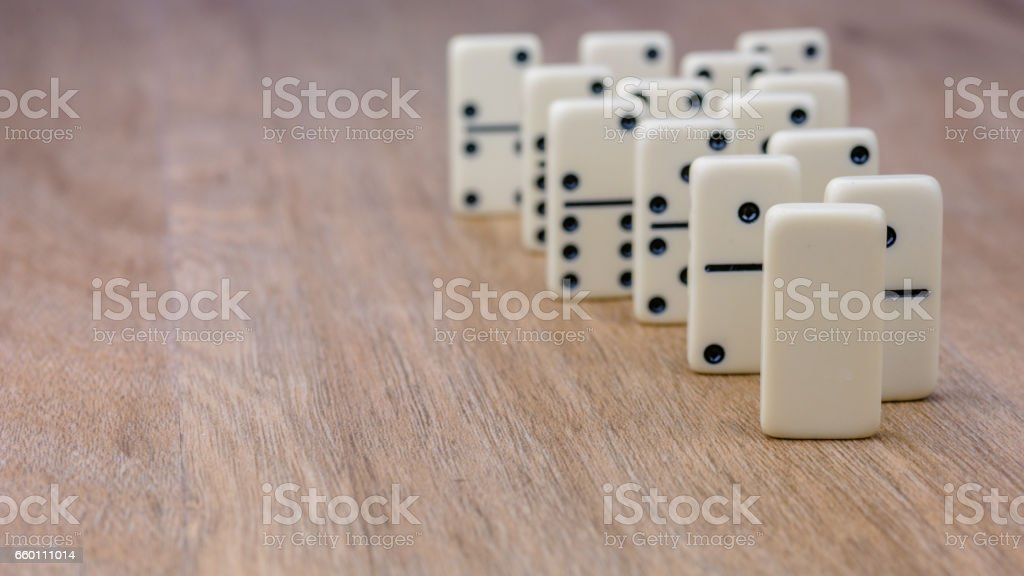 Parts of game of domino on wooden surface stock photo