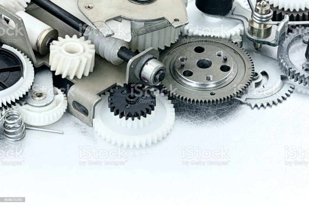 parts of industrial equpment. plastic gears and cogwheels on scratched metal background. stock photo