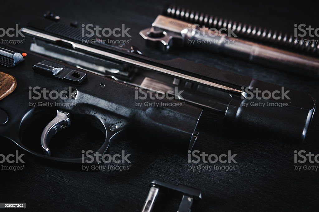 parts of the gun on the table stock photo