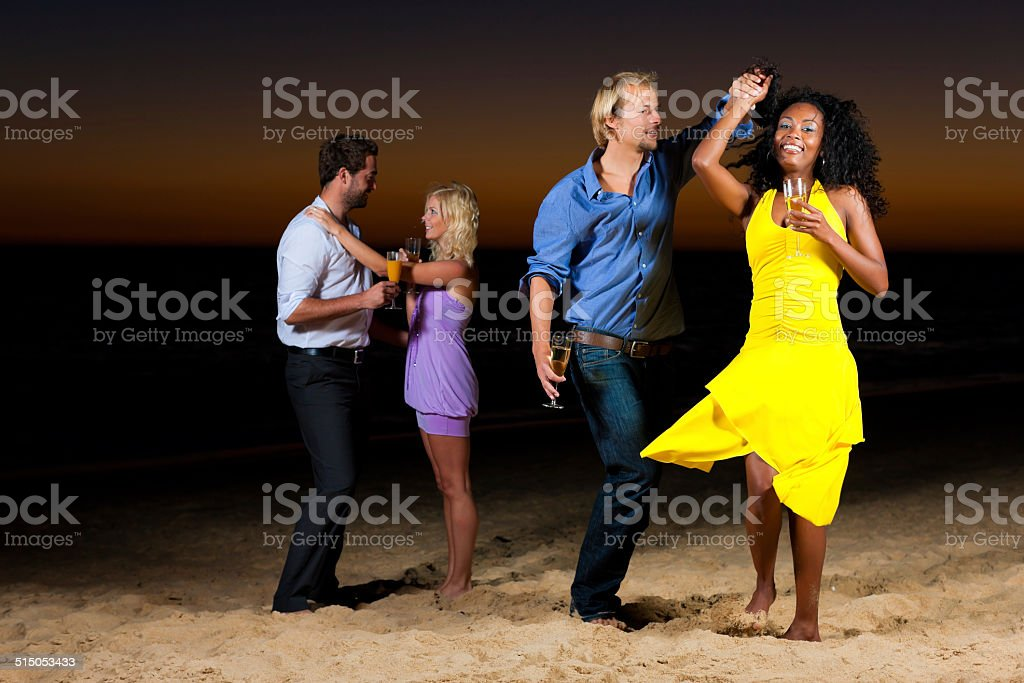 Party and dancing at the beach stock photo