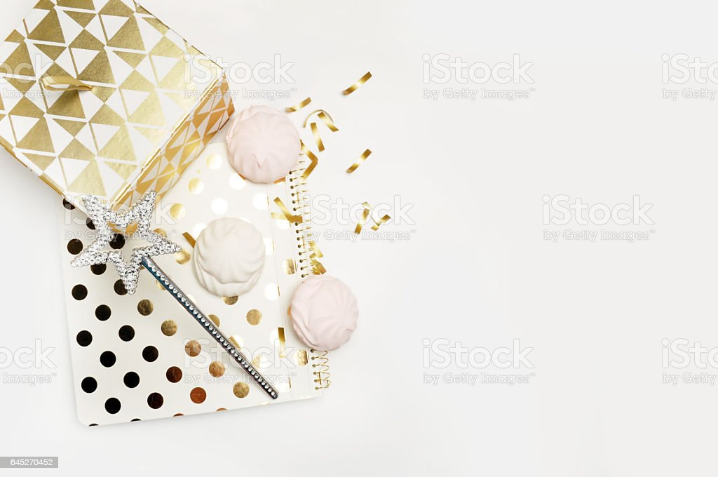 Party background mockup. Flat lay. Notebook polka gold with cakes and magic star, confetti. Header for site or Hero stock photo
