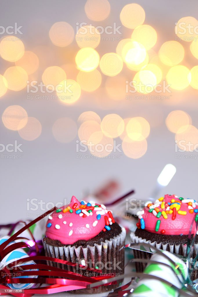 A party background with pink cupcakes stock photo