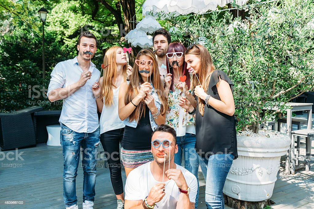 Party between a group of young friends stock photo