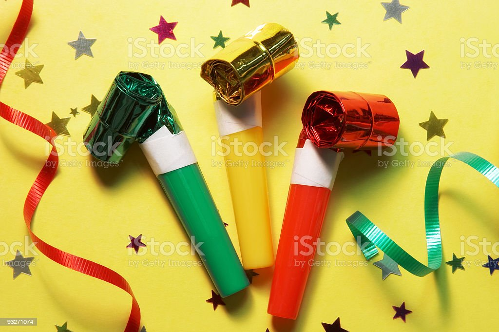 Party blowers on party themed background royalty-free stock photo