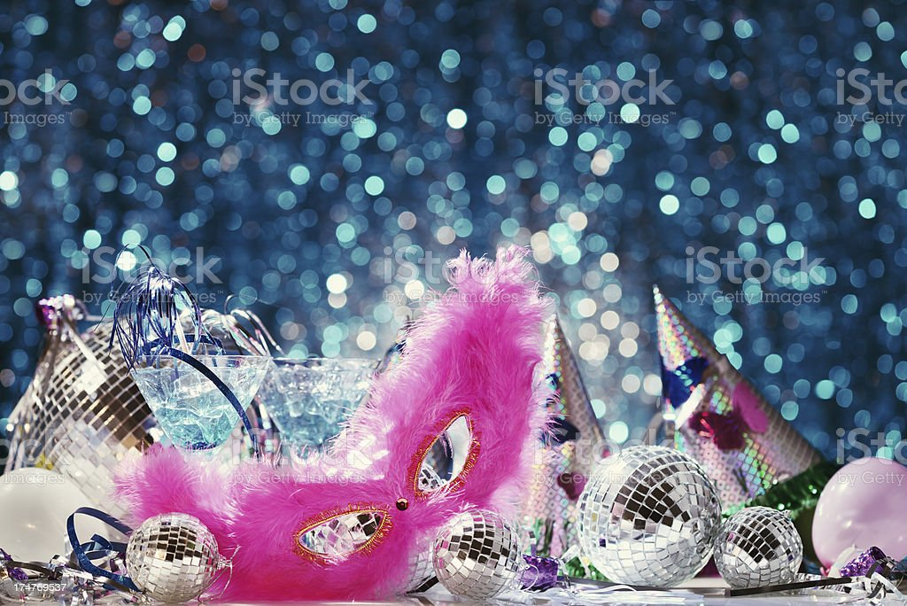 Party decoration with disco balls and feather mask stock photo