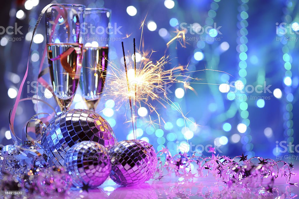 Party decoration with disco balls and fire sparkler stock photo