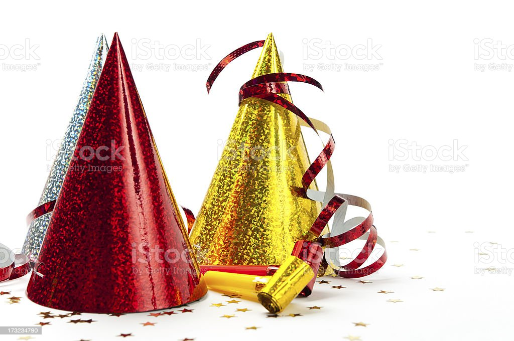 Party decorations: hats, whistles, streamers, confetti, isolated on white background stock photo
