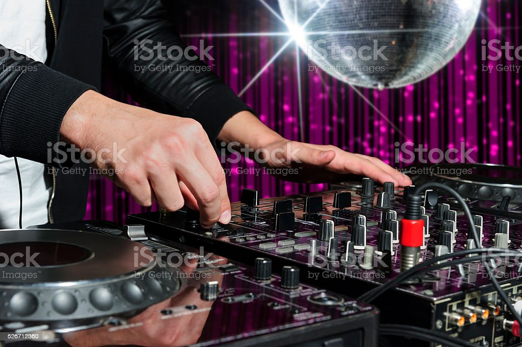 Party DJ in nightclub stock photo