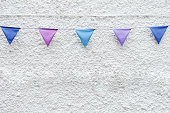 Party flags bunting white wall background. Minimal hipster style design