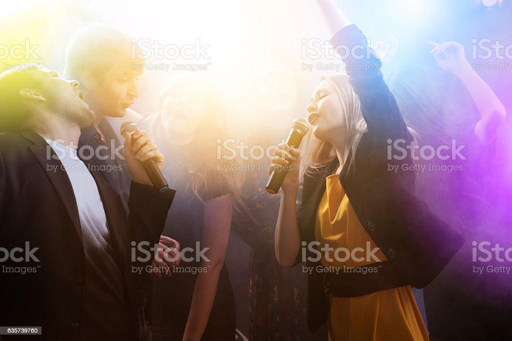 Party friends night club karaoke stock photo