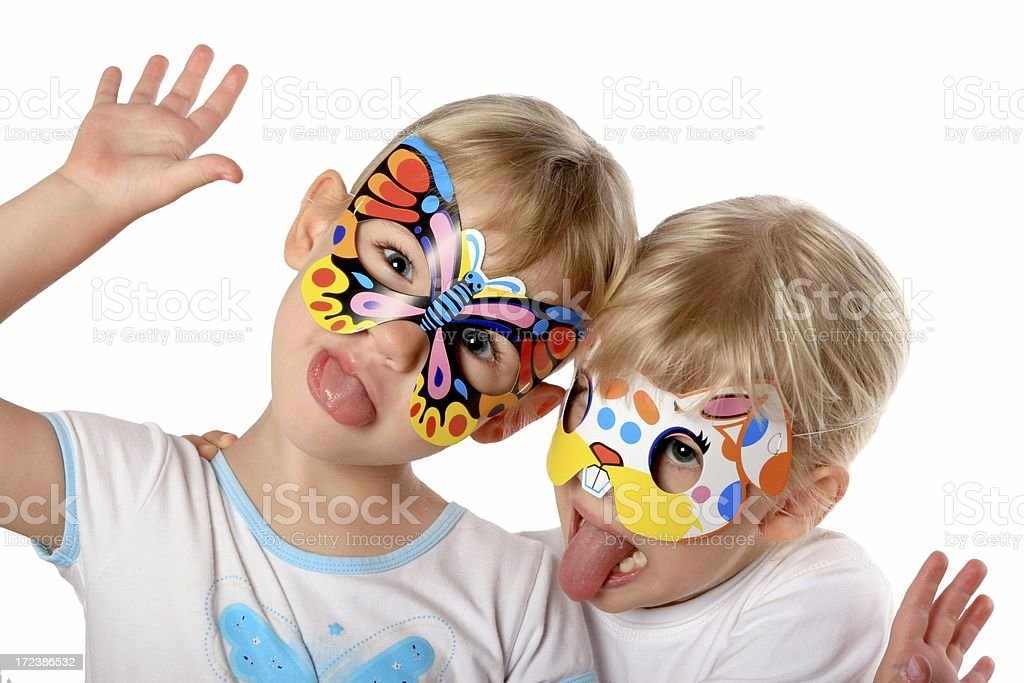 Party Girls with silly faces wearing masks on white background stock photo