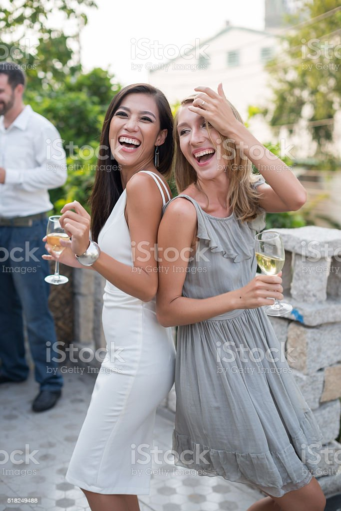 Party guests having fun stock photo