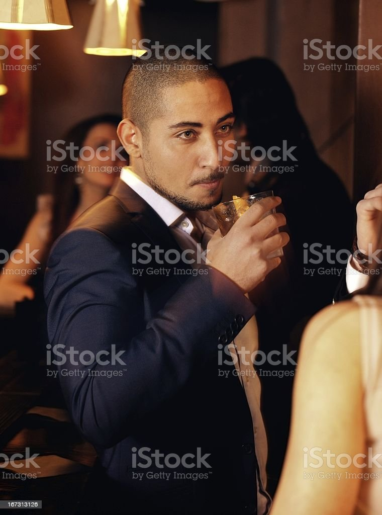 Party Guy Holding a Glass of Whiskey royalty-free stock photo
