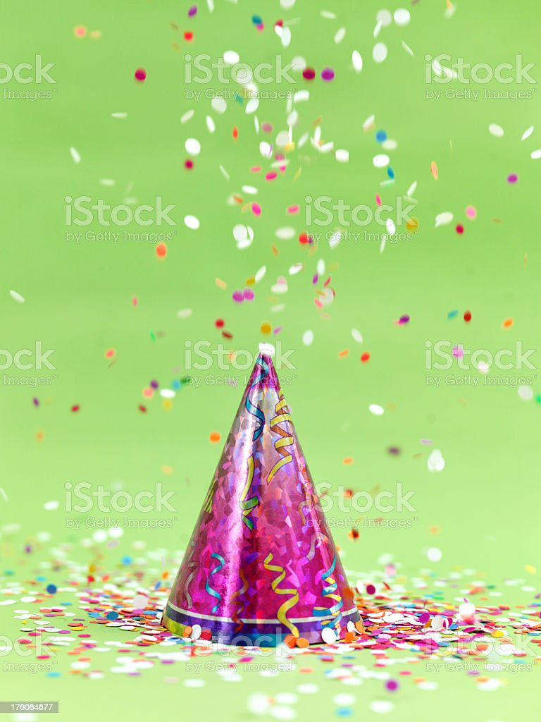 Party hat and confetti royalty-free stock photo