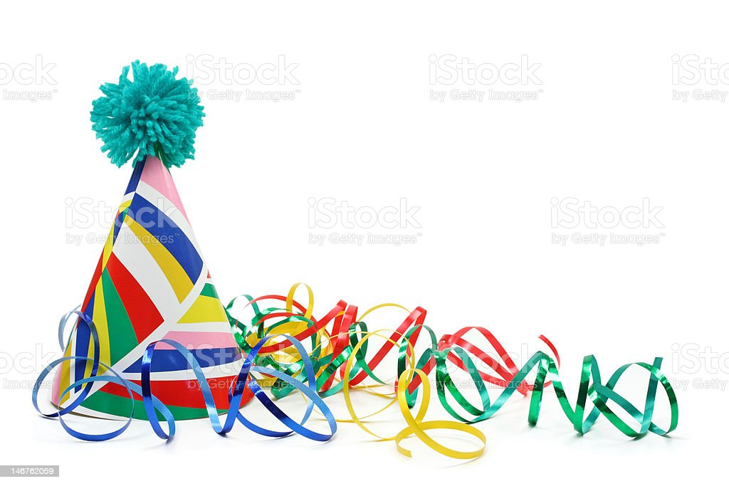 Party hat and paper streamer stock photo