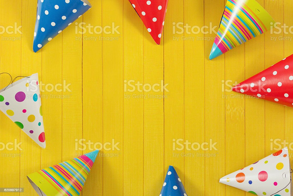Party hat on wooden background. stock photo