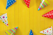 Party hat on wooden background.