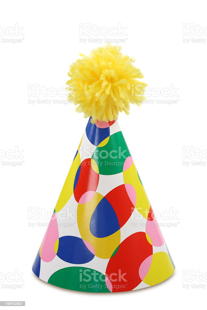 Party hat with yellow fuzzy ball stock photo