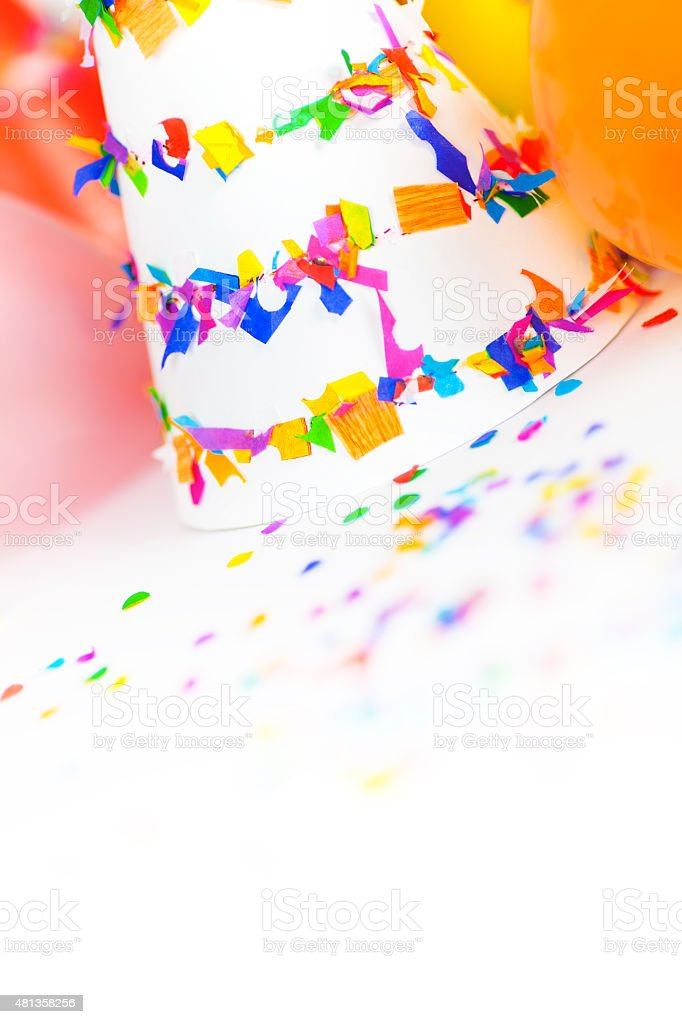 Party Hats, Balloons and Confetti stock photo
